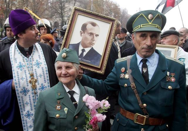 The veterans of Ukrainian Insurgent Army (UPA) hold the portrait of legendary UPA leader Stepan Bandera